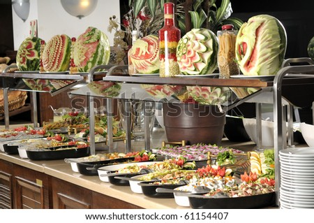 Buffet style food in trays - a series of RESTAURANT images. - stock photo