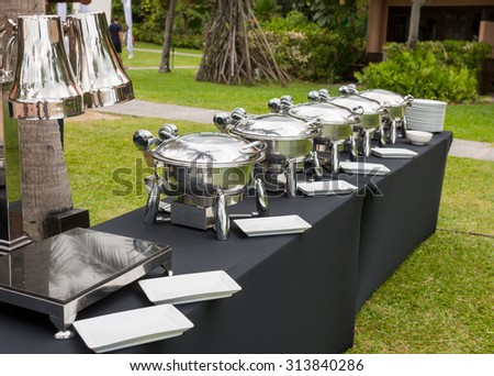Buffet Table with Row of Food Service Steam Pans