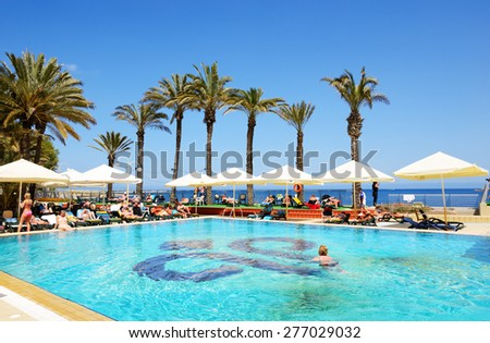 BUGIBBA, MALTA - APRIL 23: The tourists are on vacation at popular hotel on April 23, 2015 in Bugibba, Malta. More then 1,6 mln tourists is expected to visit Malta in year 2015. - stock photo