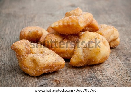 Bugne - french donut on wooden background