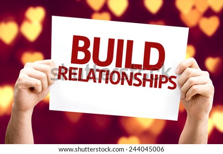 Build Relationships card with heart bokeh background - stock photo