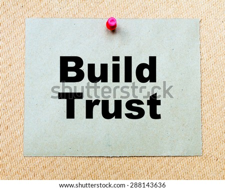 Build Trust written on paper note pinned with red thumbtack on wooden board. Business conceptual Image - stock photo
