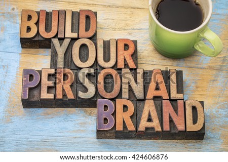 build your personal brand - motivational concept in vintage letterpress wood type block with a cup of coffee
