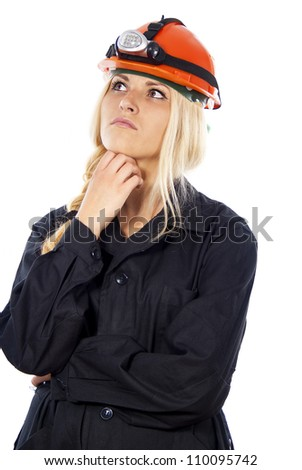 builder girl in a helmet thinking isolated on white background