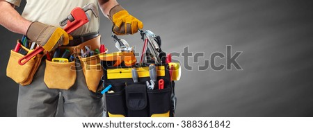 Builder handyman with construction tools. - stock photo