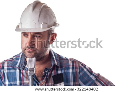 Builder in a dirty hard hat - stock photo