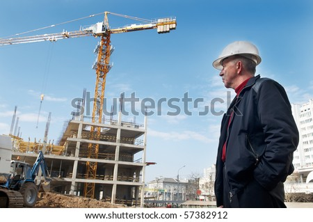 builder inspector worker checking a construction site works - stock photo