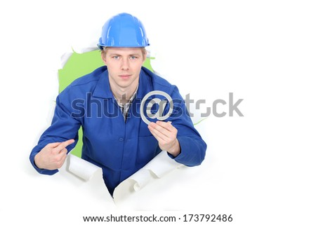 Builder promoting e-mail address - stock photo