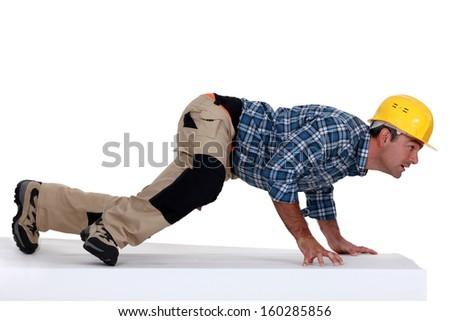 Builder pushing the floor - stock photo