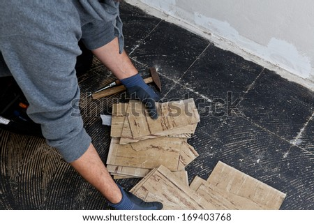 Builder Removing Damaged Floor Tiles His Stock Photo 169403768