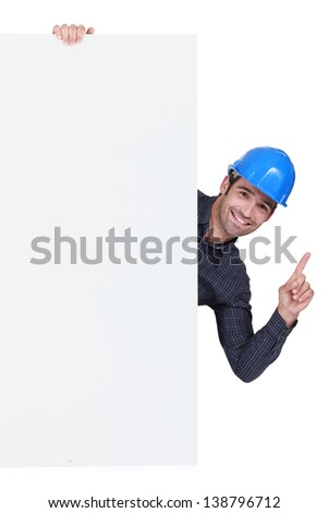 Builder stood by poster - stock photo