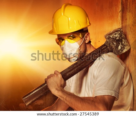 Builder with big metal hammer - stock photo
