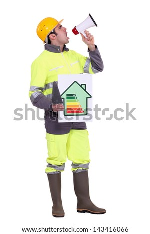 Builder with energy rating poster - stock photo