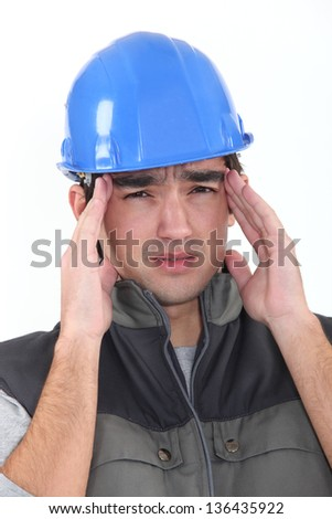 Builder with headache - stock photo