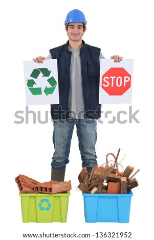 Builder with recyclable materials - stock photo