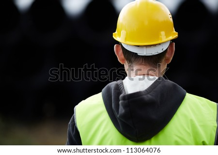 builder with yellow hard hat - stock photo