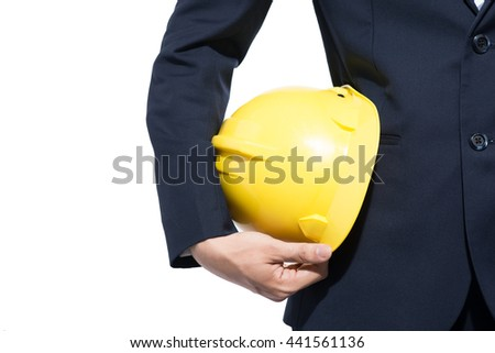 Builder with yellow hardhat and gloves isolated on white background - stock photo