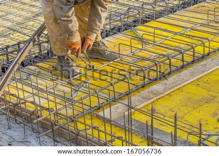 Builder worker Installing Steel Work Before Concrete Pour - stock photo