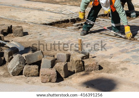 Builder worker with  crowbar breaking for construction site - stock photo