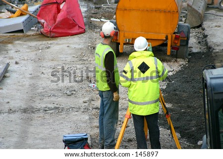 Builders discussing procedures