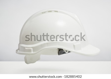Builders hard hat isolated on white background. DIY protection and safety concept - stock photo