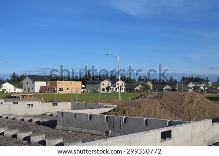 Building a family home in suburban neighborhood - stock photo