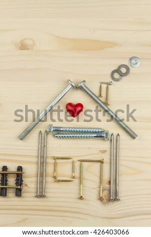 Building a house for the family. Plans to build a small house. Architect designing a house for a young family. House from nails and screws. Building a house.Building a house. Building a house.Building - stock photo