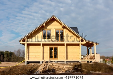 building a house with wooden logs, view the home from the outside - stock photo
