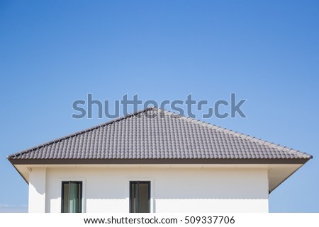 building a new roof of home, blue sky as background