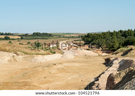 Building a road through the countryside - stock photo