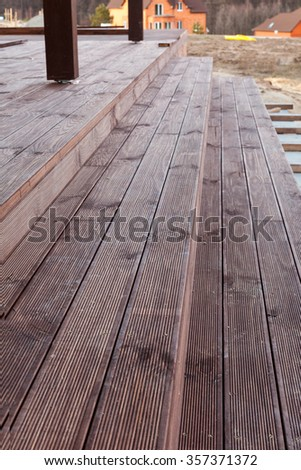 Building a stairs to wooden terrace - stock photo