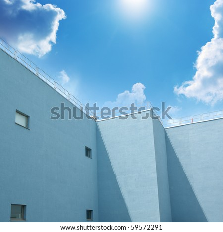 Building and blue sky. Element of design. - stock photo