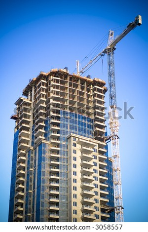 Building and construction crane - stock photo