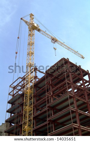 building and crane - stock photo