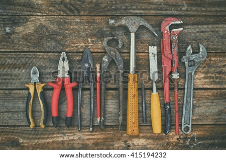 Building and treatment tools set on a wooden table, old, vintage building tools. - stock photo