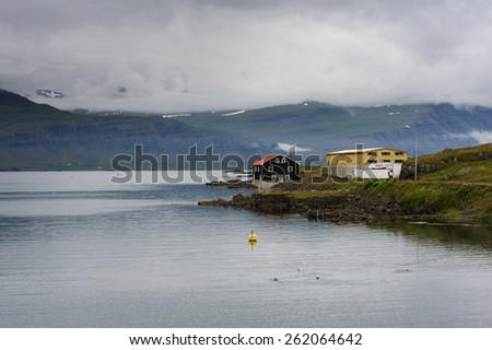 Building at the sea shore in West fjords on a cloudy day, Iceland - stock photo