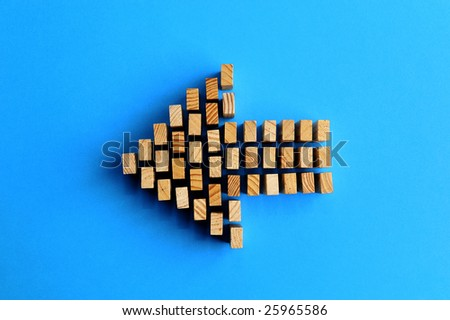 Building blocks /A arrow symbol isolated on a blue background - stock photo