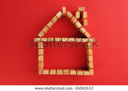 building blocks /A house symbol isolated on a red background - stock photo