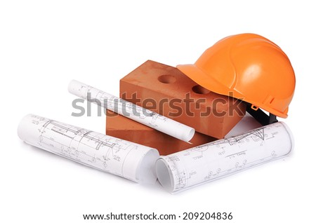Building brick with helmet isolated on white - stock photo