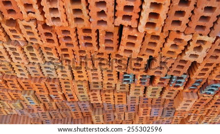 Building bricks stacked wall background - stock photo