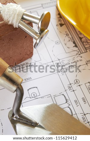 Building Components Arranged On House Plans - stock photo