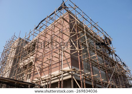 Building construction against blue sky for real estate design background - stock photo