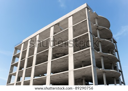 Building construction on the background of blue sky - stock photo