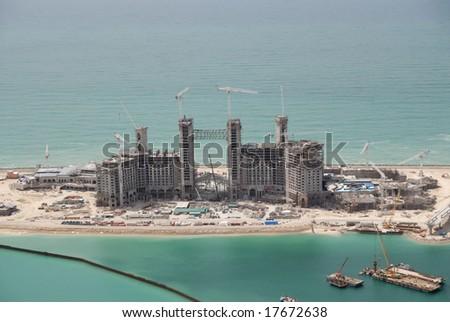 Building Construction On The Head Of The Jumeirah Palm Island In Dubai - stock photo