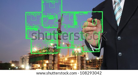 Building construction site at twilight - stock photo