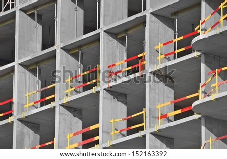 Building construction site from concrete with railing - stock photo