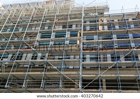Building construction site with scaffolding.  - stock photo