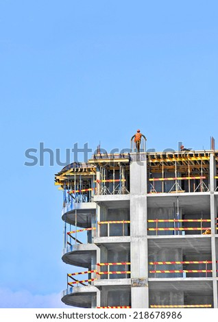 Building construction site work against blue sky - stock photo