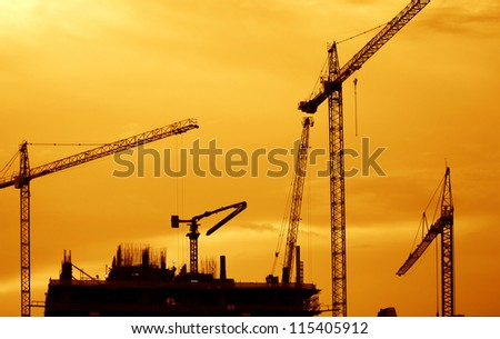Building Construction with Cranes in the evening. - stock photo