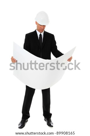 Building contractor checking blueprints. All on white background. - stock photo